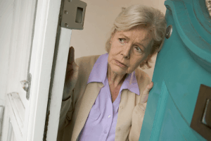 An elderly checking the door