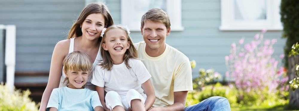 Happy family in front of a secure home