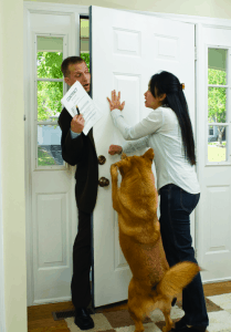 A door to door salesman stopped by the resident and her dog